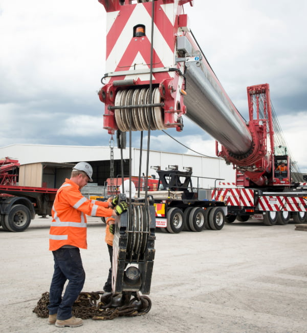 Engineers guiding the crane