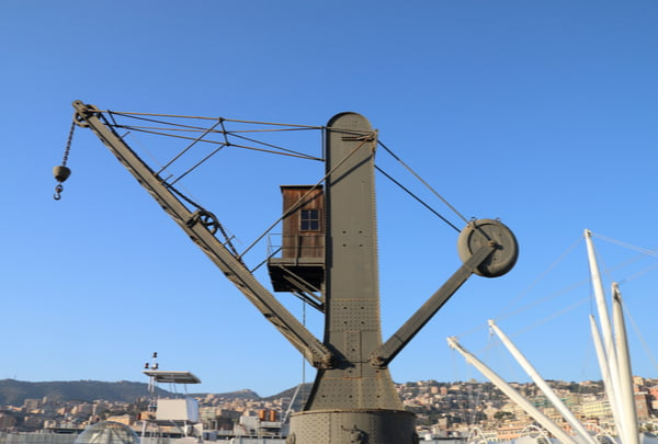 An old crane for loading cargo ships inside the ancient port of Genoa